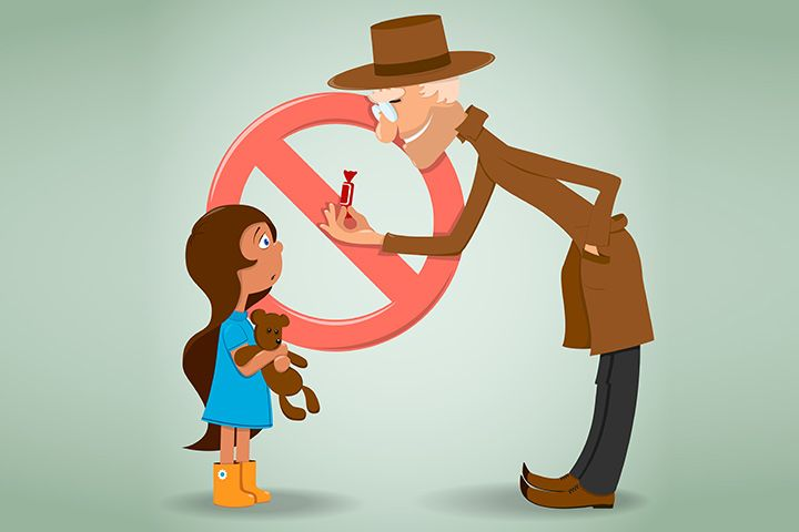 Hombre ofrece caramelo a niña